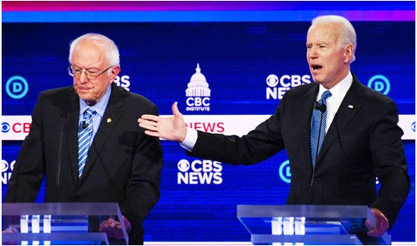 Ish Nënkryetari Joe Biden dhe Sen. Bernie Sanders gjatë një debati. (AFP)